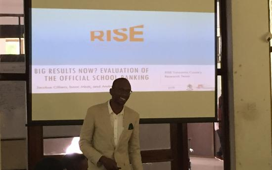 Isaac Mbiti presents at the biannual RISE Stakeholder Reference Group meeting in Dar es Salaam.