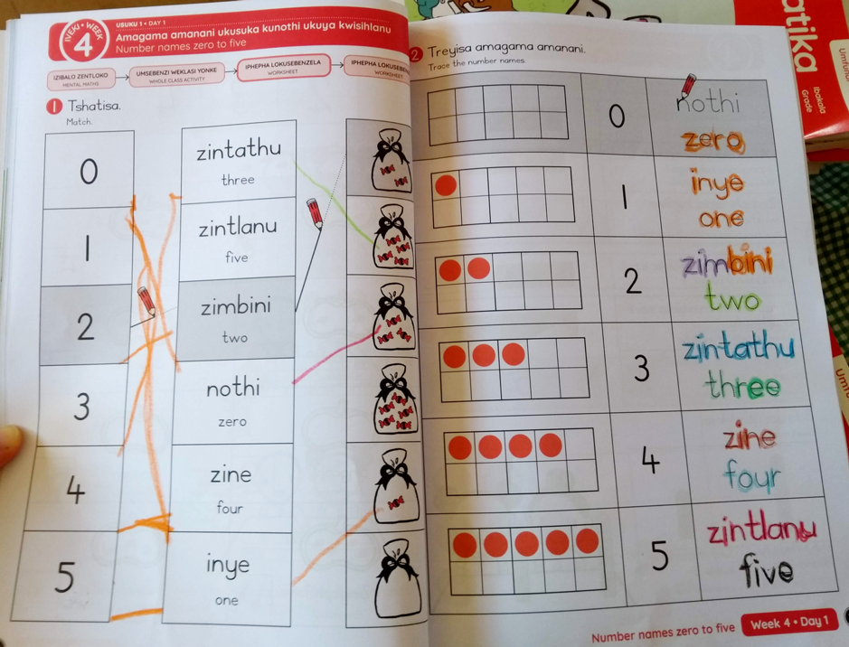 Two pages of an exercise book with mathematics problems using words and numbers