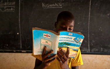 Tanzanian school boy reading