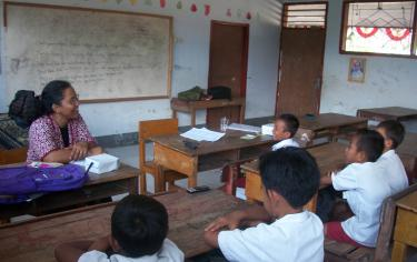 teacher with boys in class