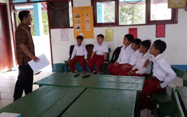 teacher with children in class