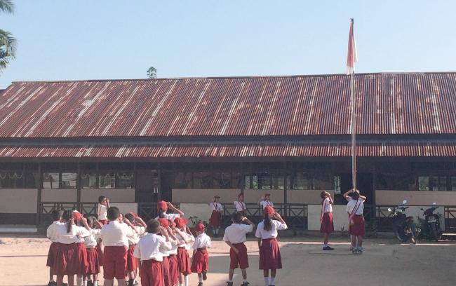 Students standing outside of a school in Indonesia