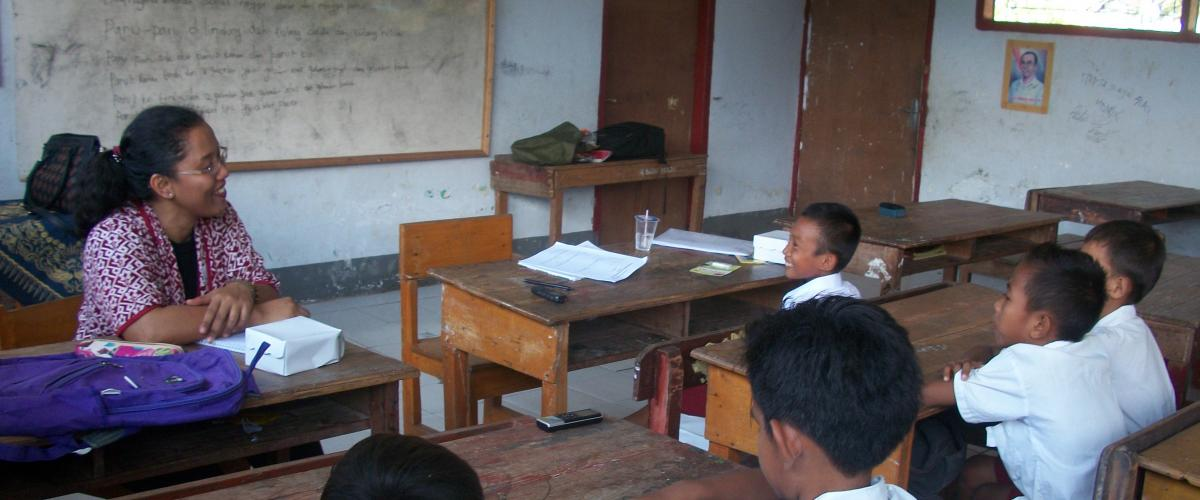 teacher and children in classrom